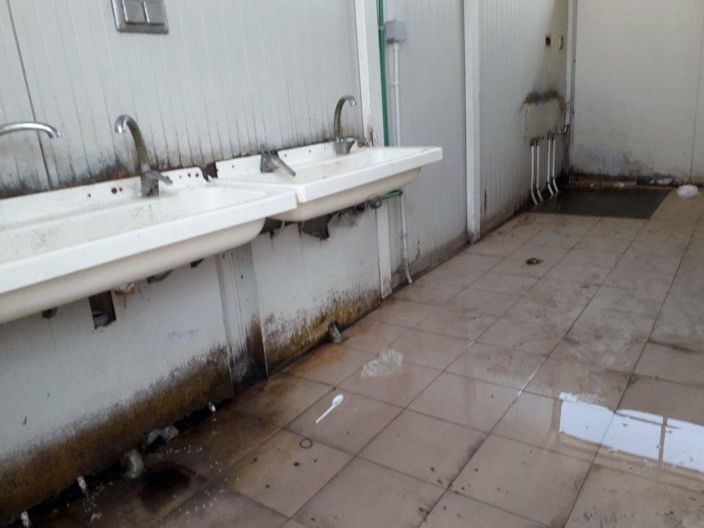 An unclean camp bathroom, near Foggia, Italy. July, 2018. © Pamela Kerpius