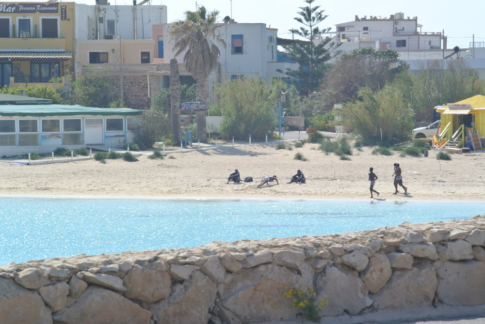 Lampedusa: recent arrivals exercise at  Guitgia  beach. Lampedusa, Italy; April 2017. © Pamela Kerpius