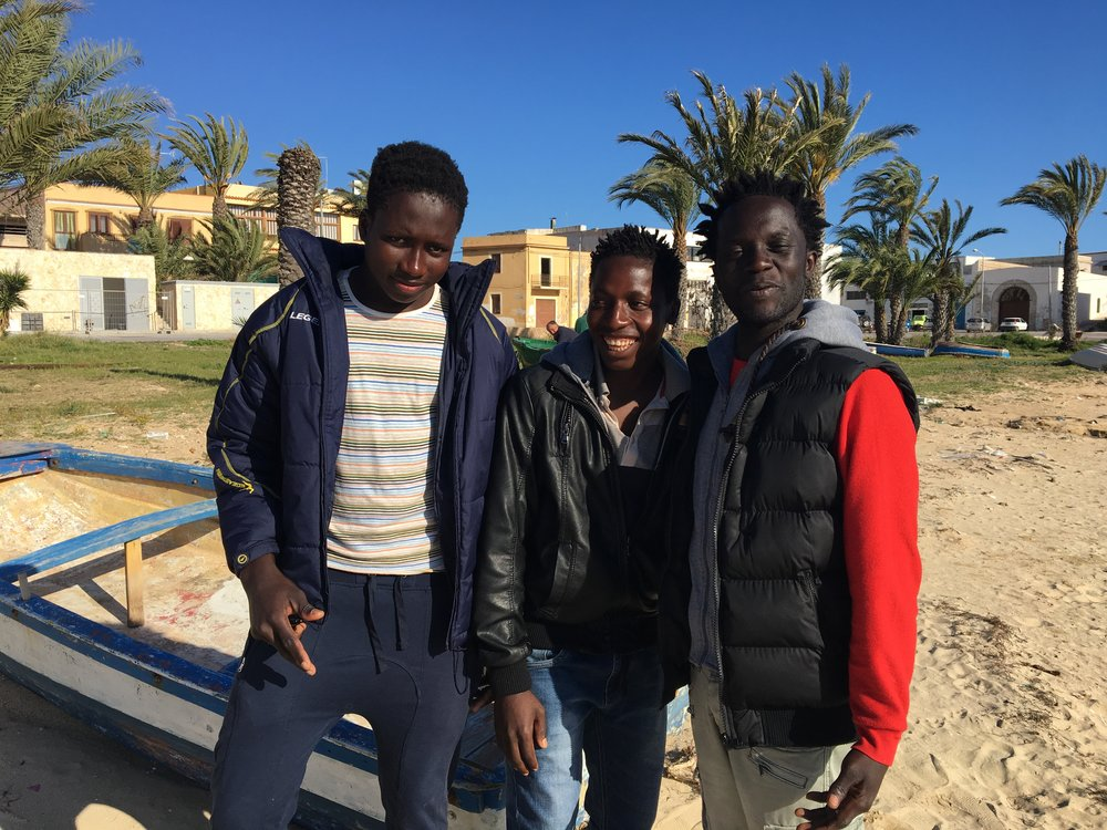 Ebrima and friends posing for the camera. Lampedusa, Italy; 3 April 2017. ©Pamela Kerpius