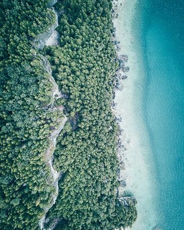 above view of land meeting ocean.jpg