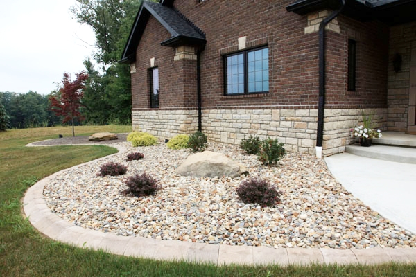 Rock Bed - Decorative gravel has really taken off! Change existing mulch or pine straw to pea gravel, river pebbles, or Alabama rose stone for a unique and longer lasting bed!