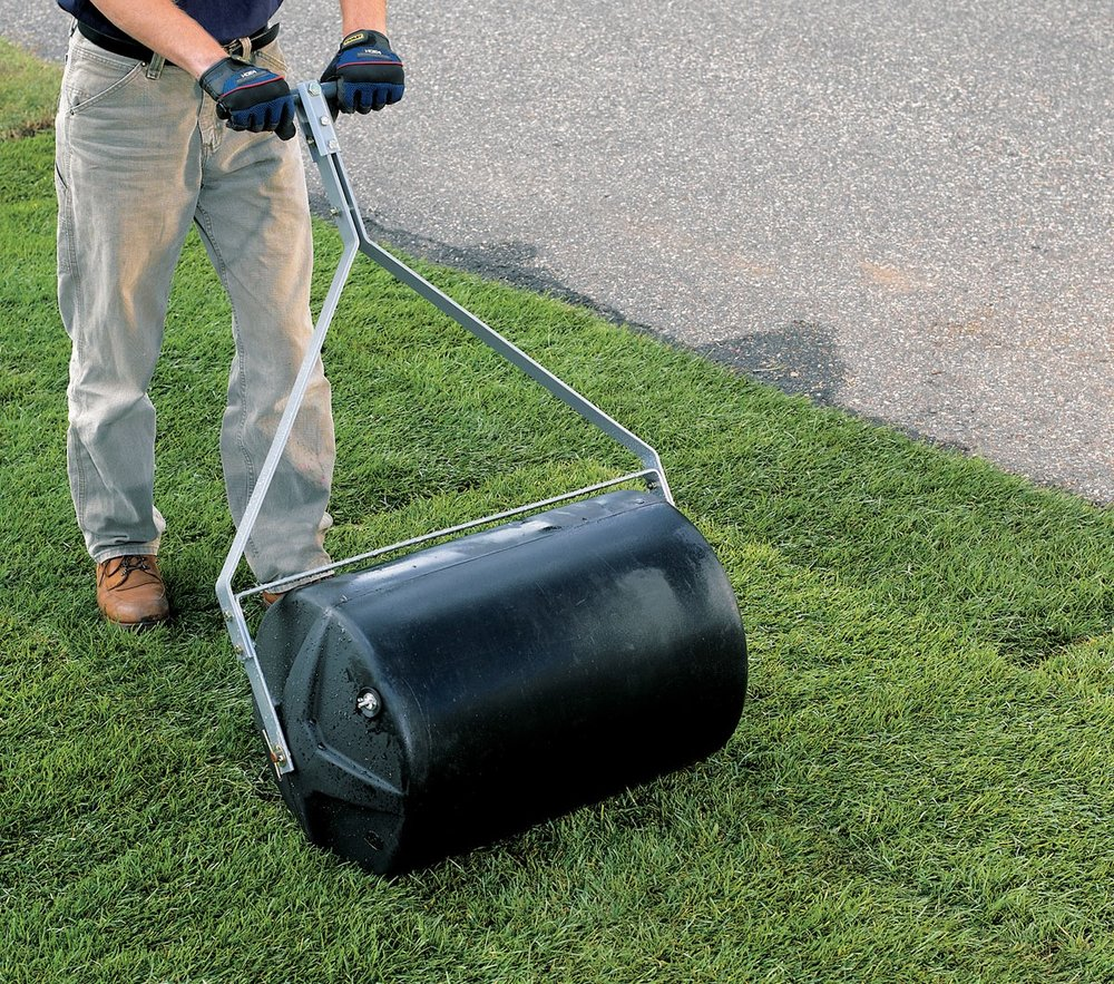 4. Use a sod roller to tightly press the sod   into the soil, which gives the roots immediate access to moisture.