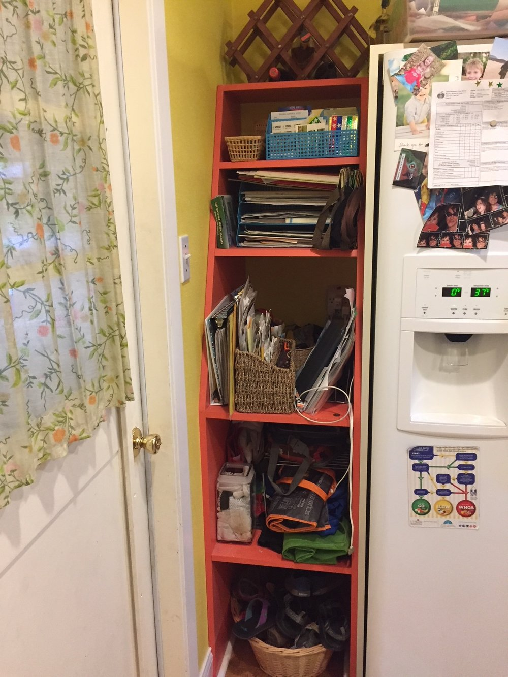 BEFORE: Pre-pruning, Jennifer's shelves were a mix-and-match of filled-up folders, mystery papers and more (plus, a source of mild anxiety for her adoring hubby)!
