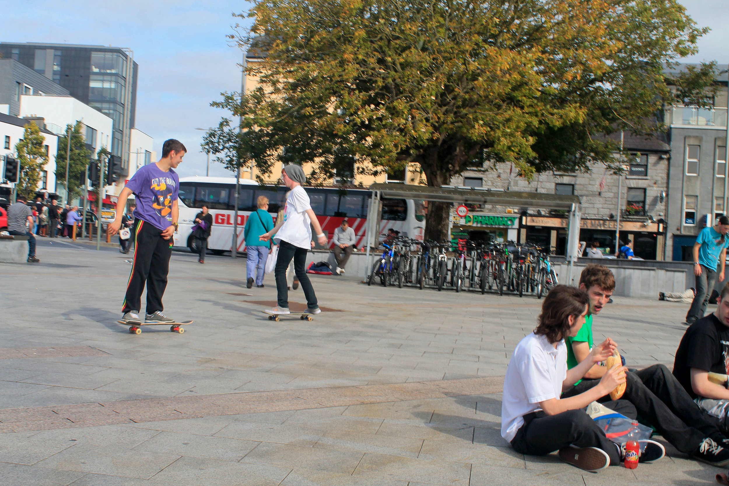 Teenagers skateboard in Galway's main meeting point, Eyre Square.