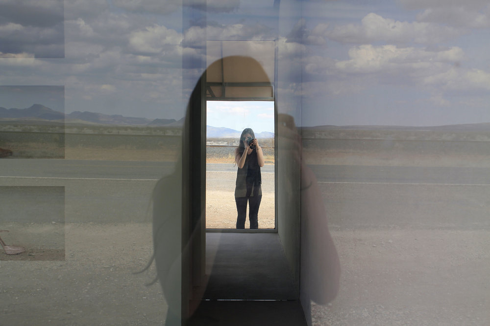 Most photos show Prada Marfa in the context of its surroundings. I loved looking into this mirror inside of it. It perfectly captures how strange and compelling Marfa's art scene is.
