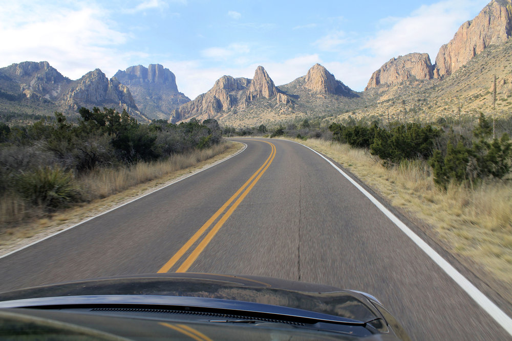 You can never have too many road pictures in Big Bend. The park is so huge, that you could spend an entire day driving around it — and still never be bored. Pictured at the Chisos Mountains, which make me wonder if we're actually still in Texas, because these guys paint quite a different picture than the stereotype.