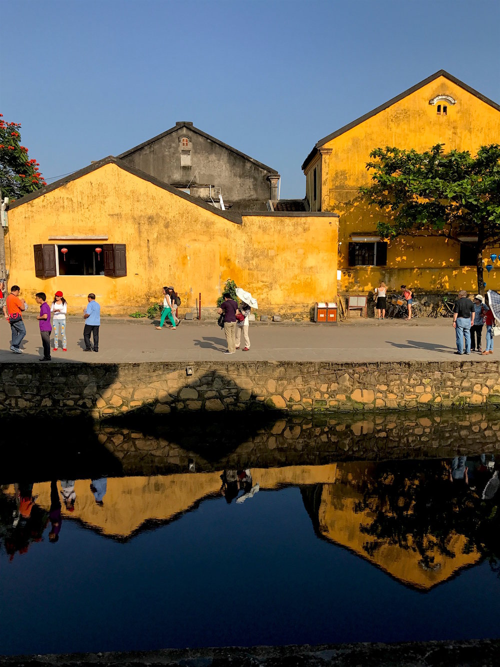 Many of the buildings in Hoi An are culturally protected, so their aging yellow facades remain intact.
