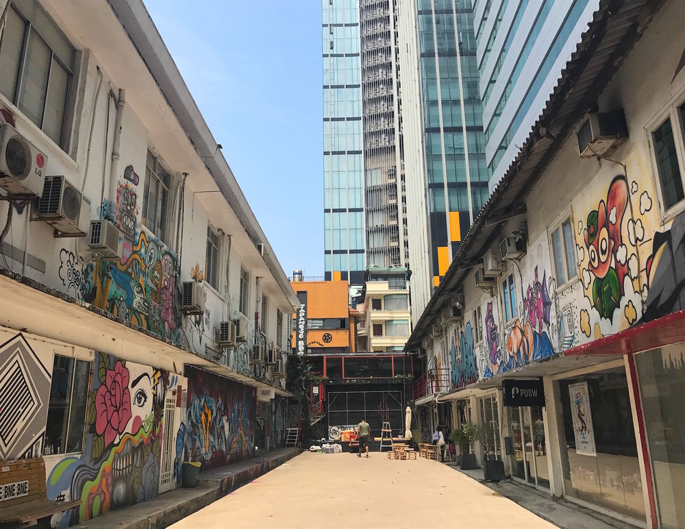 The 3A Alternative Art Area is tucked away beside a busy street and construction area. Coffee shops and boutiques fill the street art-covered buildings.
