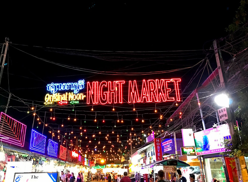 Neon-lit night markets cover the walkable area of town.