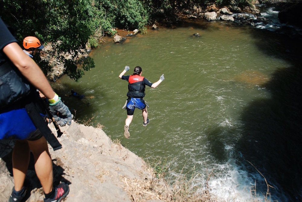 Jumping off of a cliff during a canyoning trip in Da Lat, Vietnam.