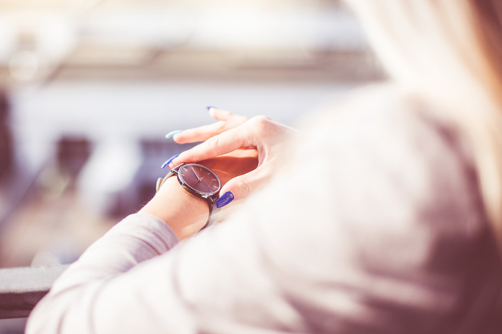 woman-checking-the-time-on-her-fashion-watches-picjumbo-com.jpg