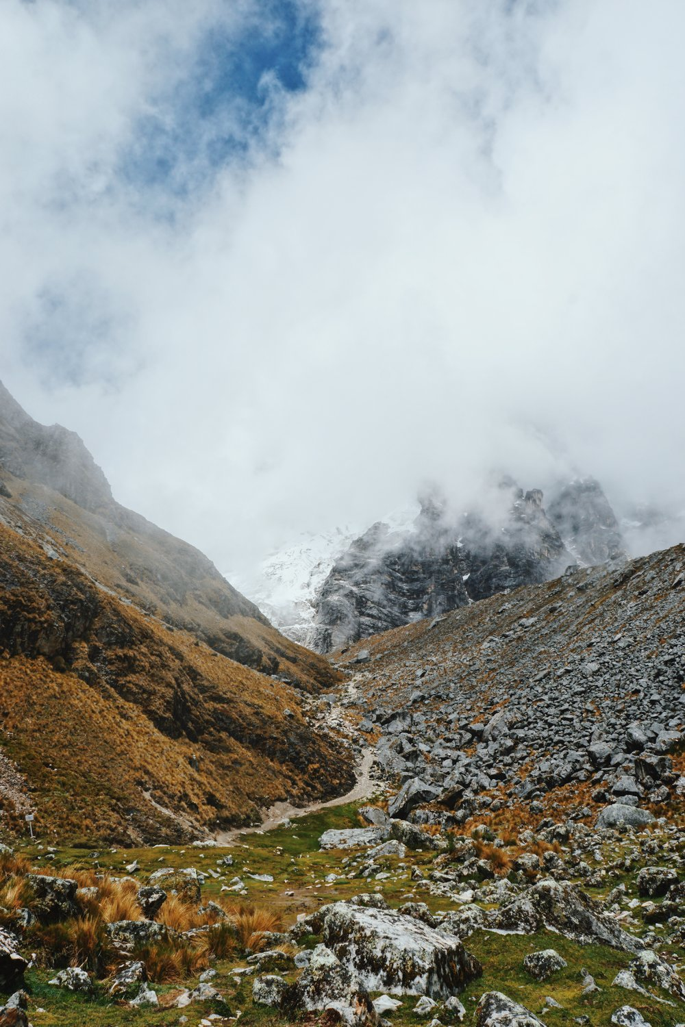 Catching glimpses of snow-capped mountains going over the Salkantay Pass.