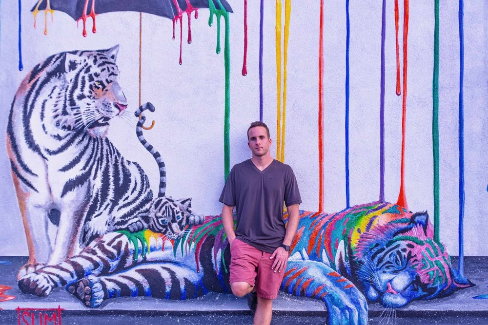 claenslate-jeff-brogger-photo-shoot-carlsbad-san-diego-california-dj-portrait-with-colorful-mural-backdrop