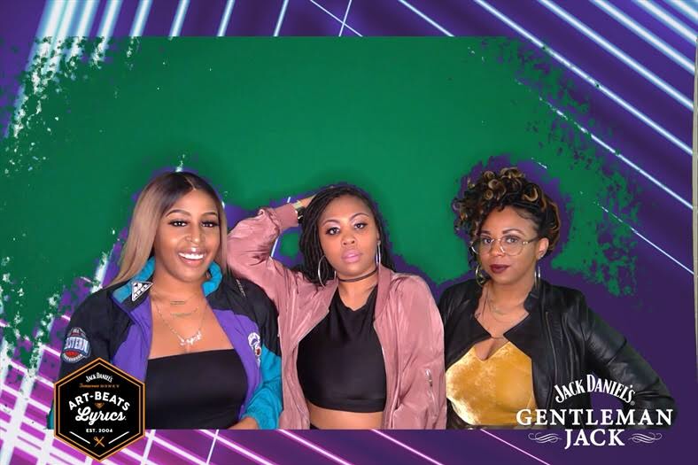 Lauren, Jashia, and I take a picture at the green screen.