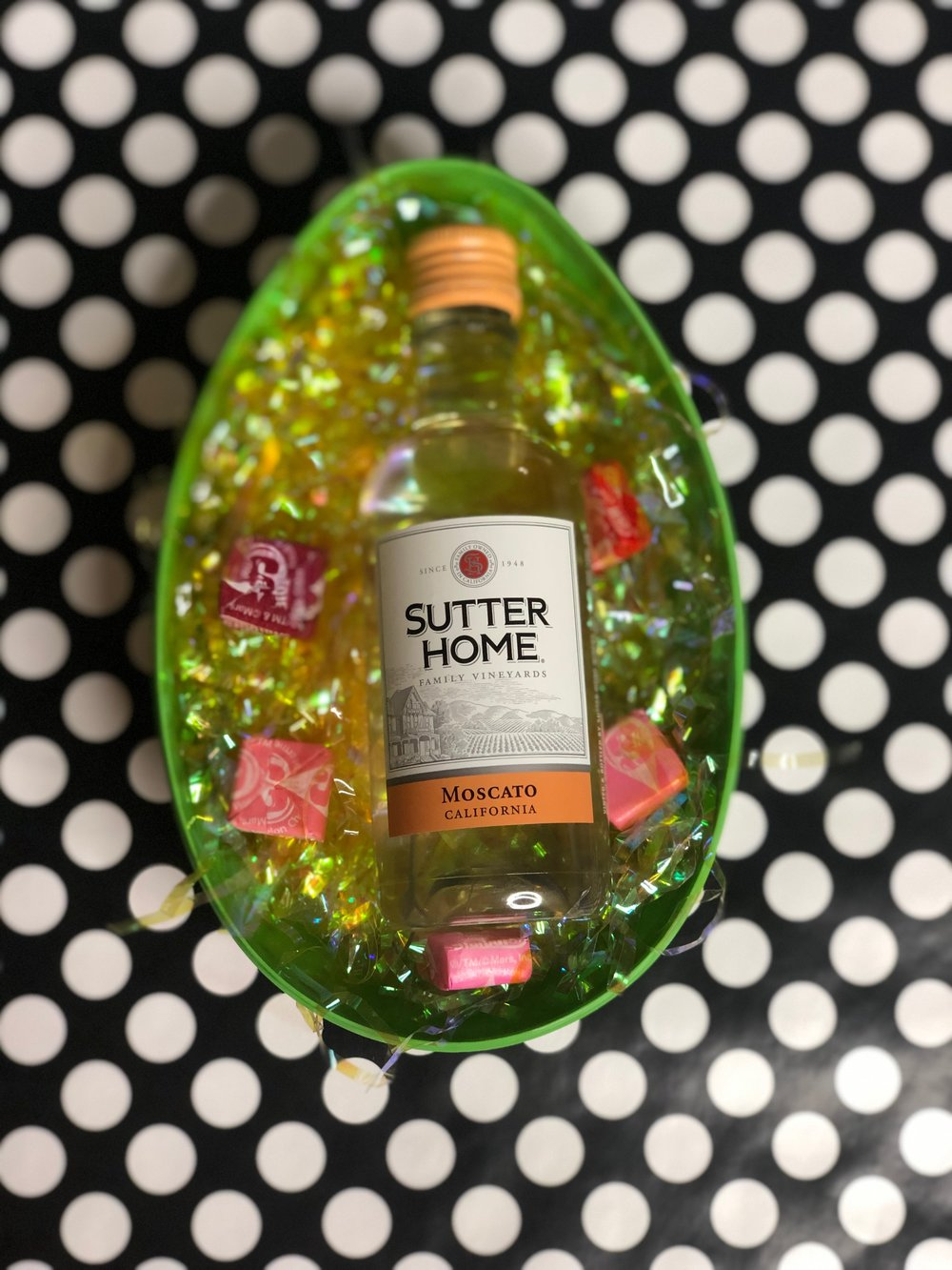 Step 3 - Place your mini Wine bottles in the plastic Easter Eggs.