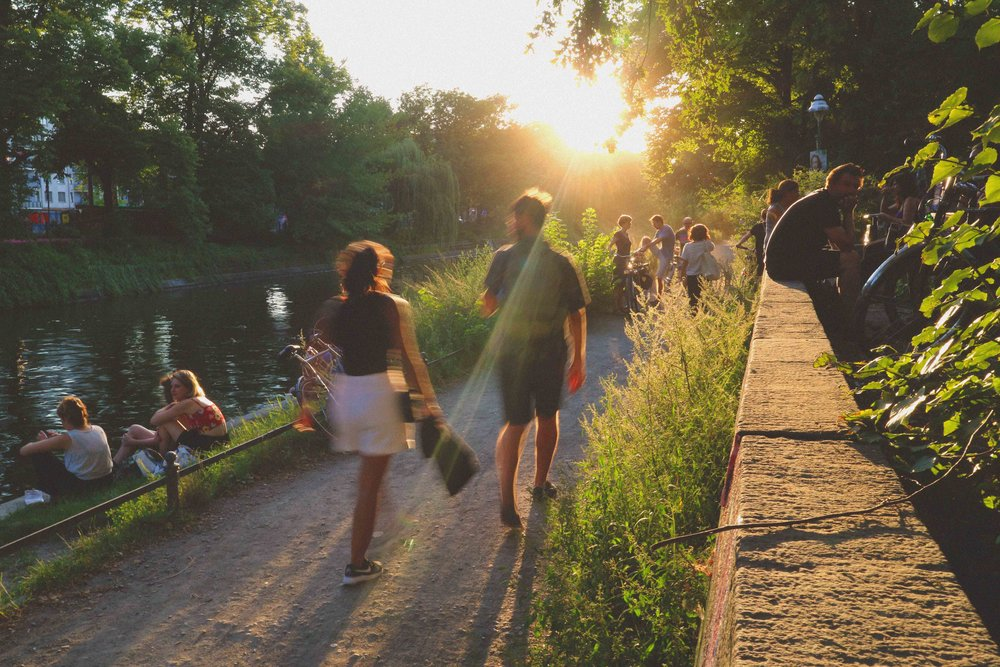 Berliners chilling on the Landwehr canal on a sunny evening