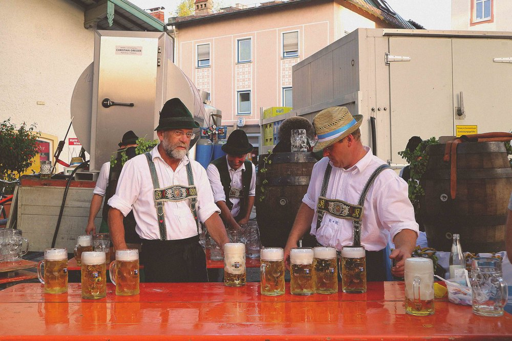 Two locals handing out pints at the bank holiday celebrations