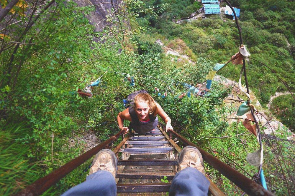 Carol climbing the 40 metre ladder