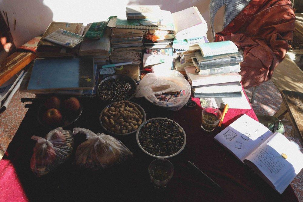 Grandma Lui's table full of notebooks and tasty snacks