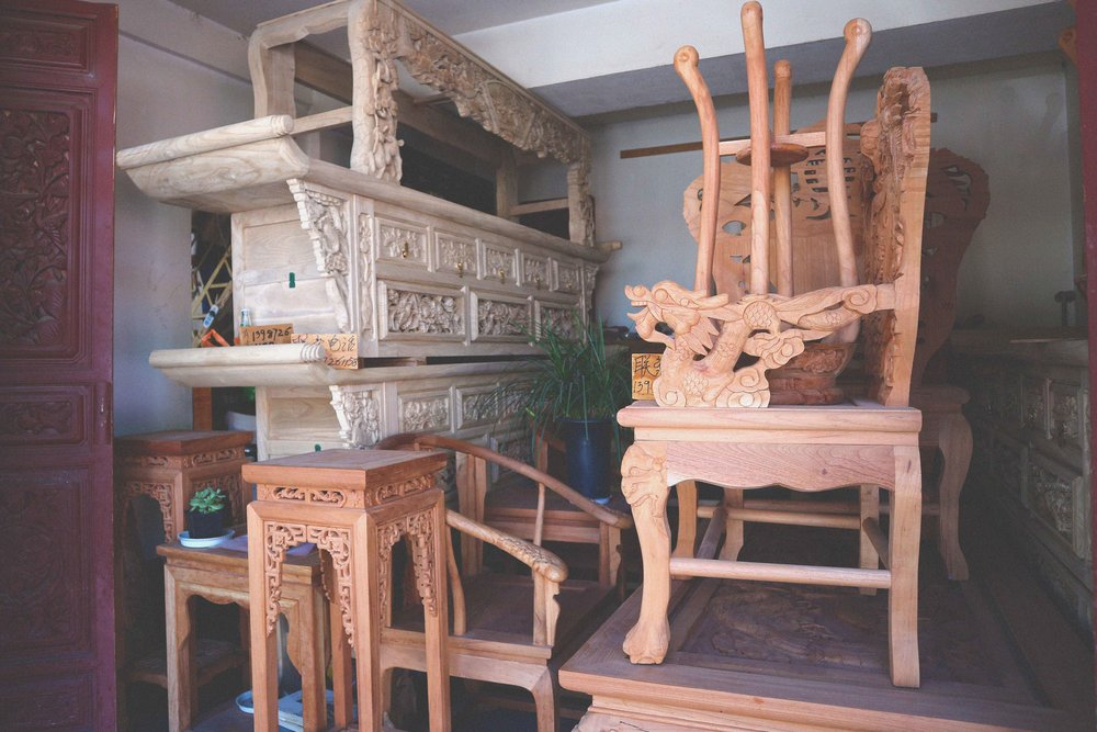 Hand-carved wooden furniture in Dali