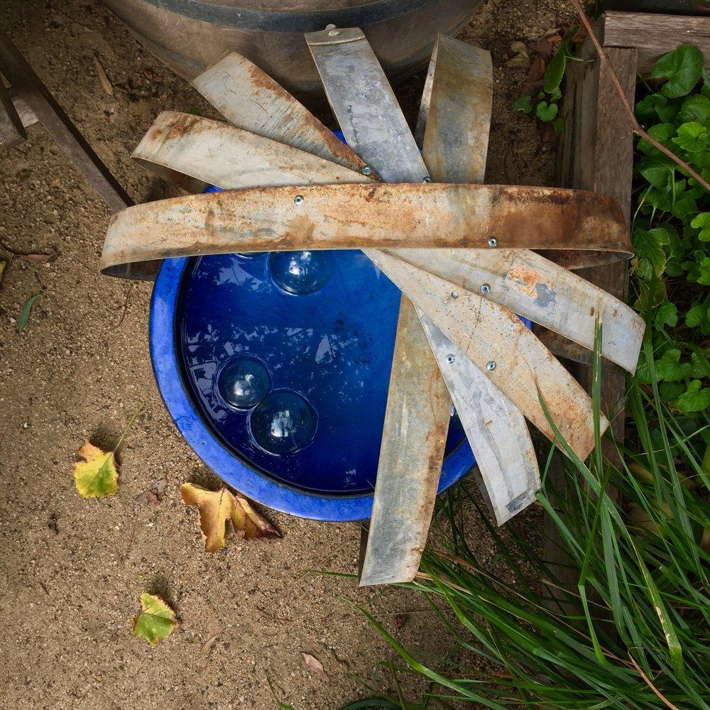 Up Cycling Wine Barrel Rings Into Garden Art Steven Wells The Gardener