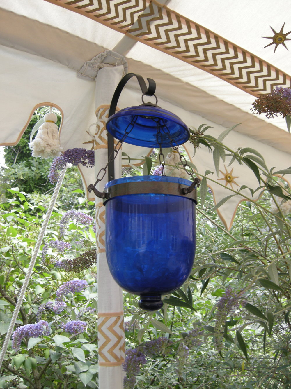 "Small blue hanging lantern, not fitted for electricity, approximately 12"" high; 6"" wide"