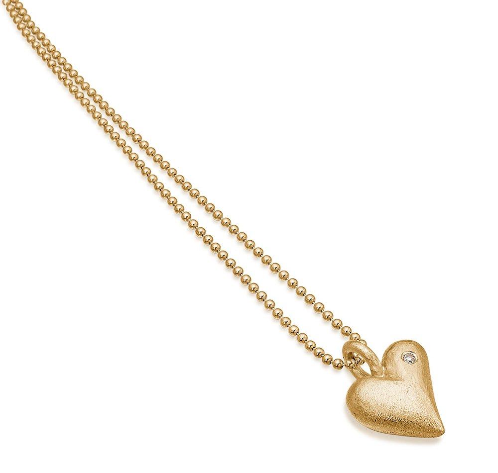 Sort massivt guld hjerte med diamant.