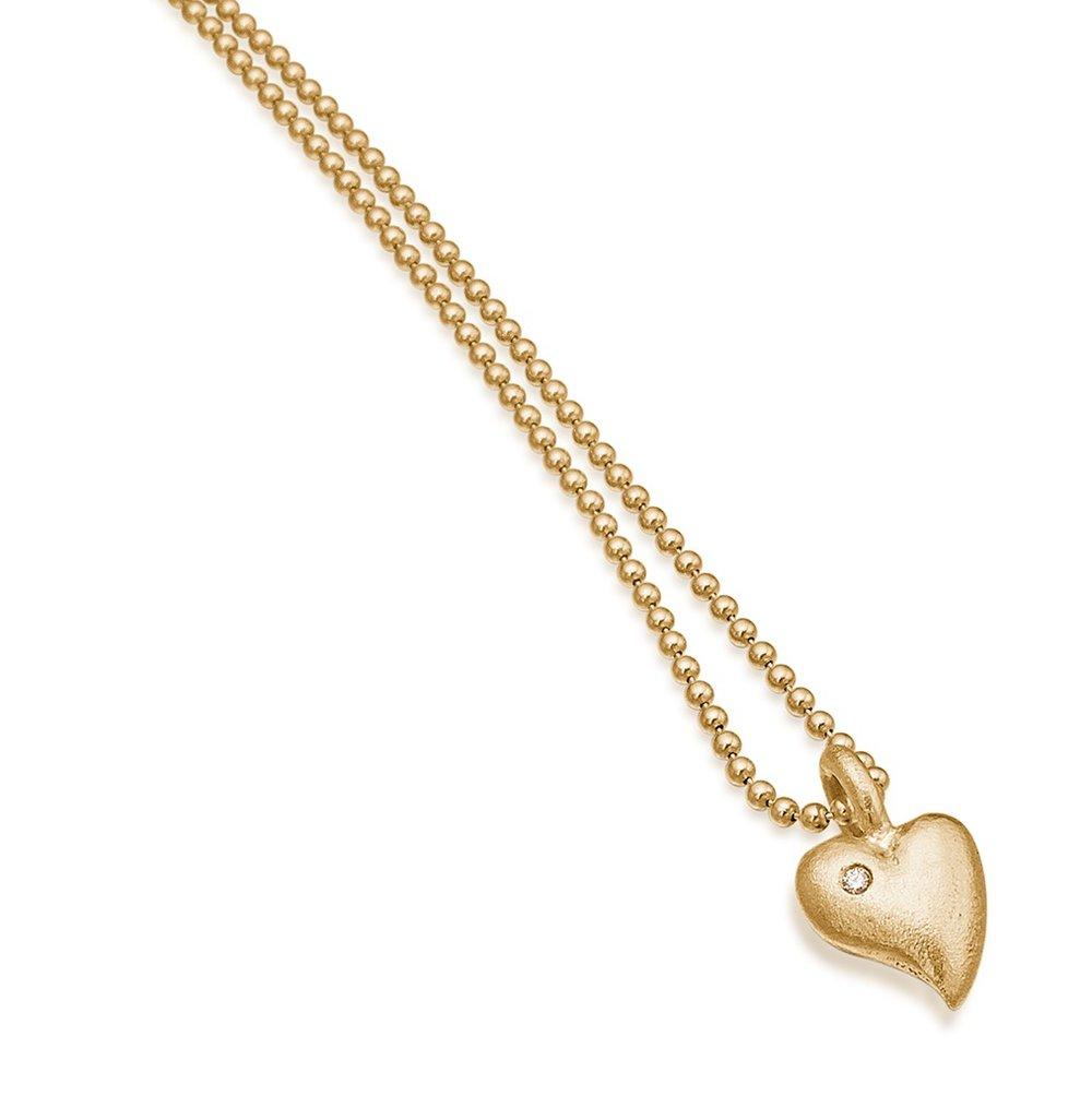 Lille massivt guld hjerte med diamant.