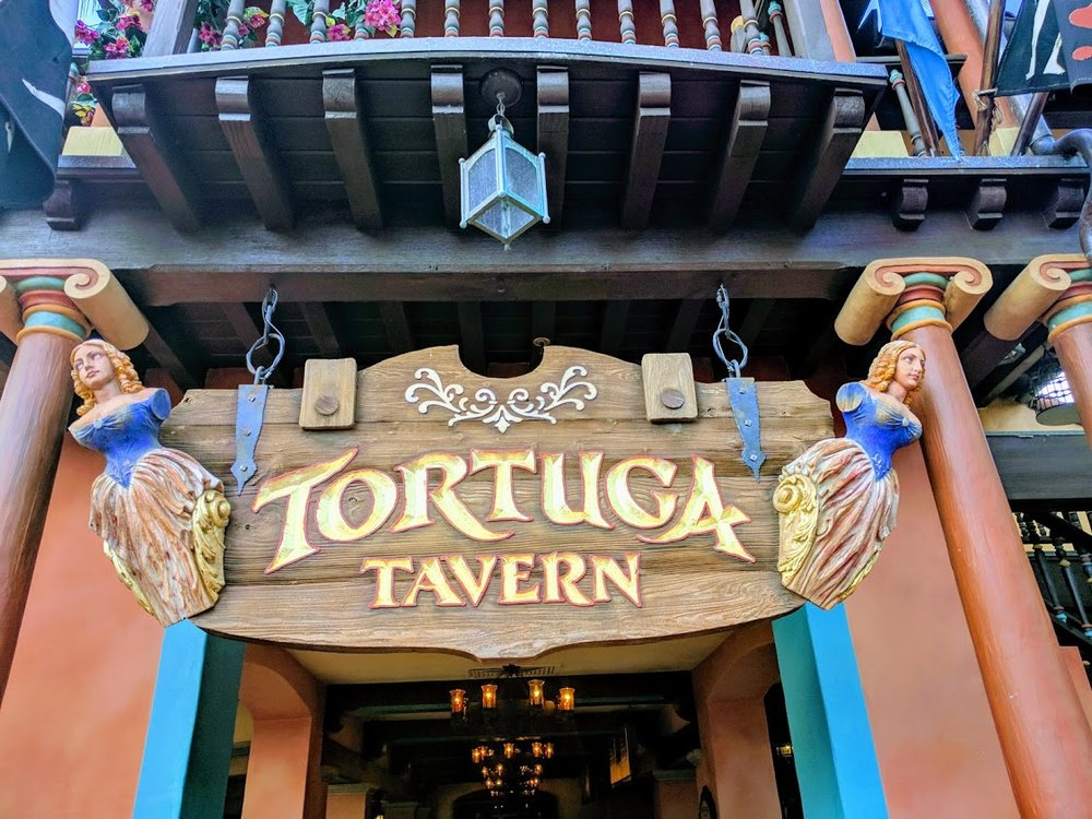 Tortuga Tavern is located across from Pirates of the Caribbean in Adventureland.