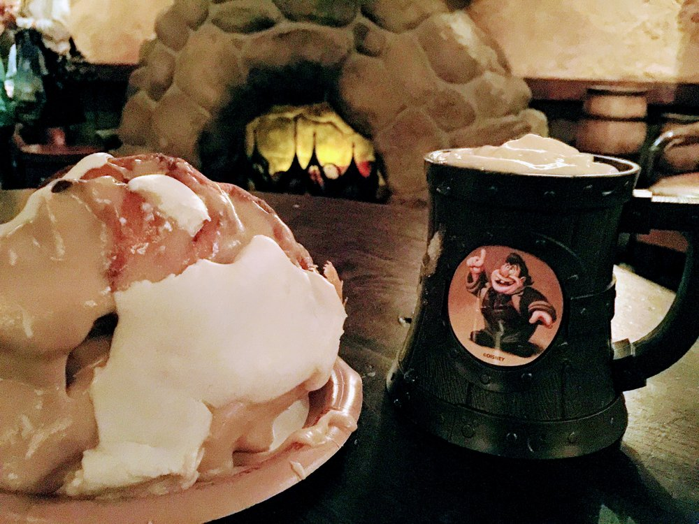 Warm Cinnamon Roll and LeFou's Brew in the souvenir stein.