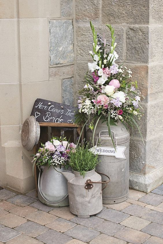 vintage-milk-churns-and-flowers-wedding-decor.jpg