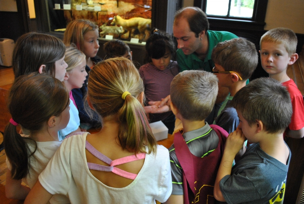 Marc Van Horn running a museum education program at the Bohannon Schoolhouse (Mount Pleasant, MI).