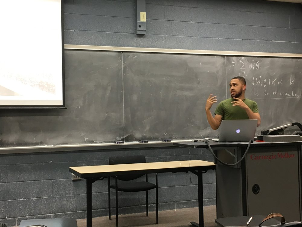 "student gives an in-class presentation while researchers (""faculty"") and peers record feedback"