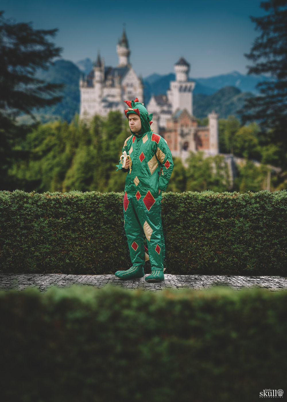Piff The Magic Dragon outside a magical castle by Little Skull Photography