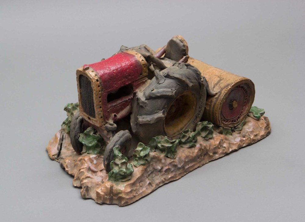 "Tractor Rolling Sugar Beets    1975    7"" x 17 x 10   raku fired stoneware"