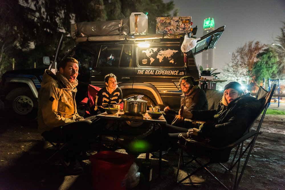camping-santiago-parking-lot-with-other-overlanders.jpeg