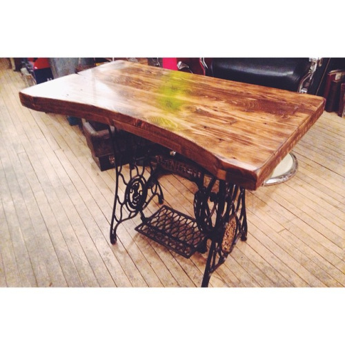 $ Inquire A singer sewing machine base with a salvaged piece of wood from our demolition site at High Park and Roncesvalles.