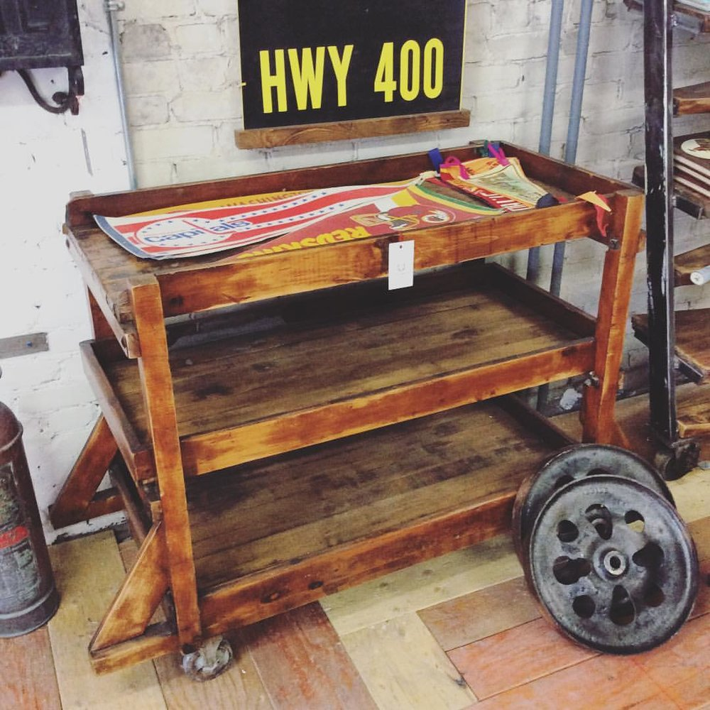 $ Inquire Multi level rolling cart. Made from reclaimed wood and scrap wheels, it's purpose is to be used as a kitchen island but works well for lots of things.
