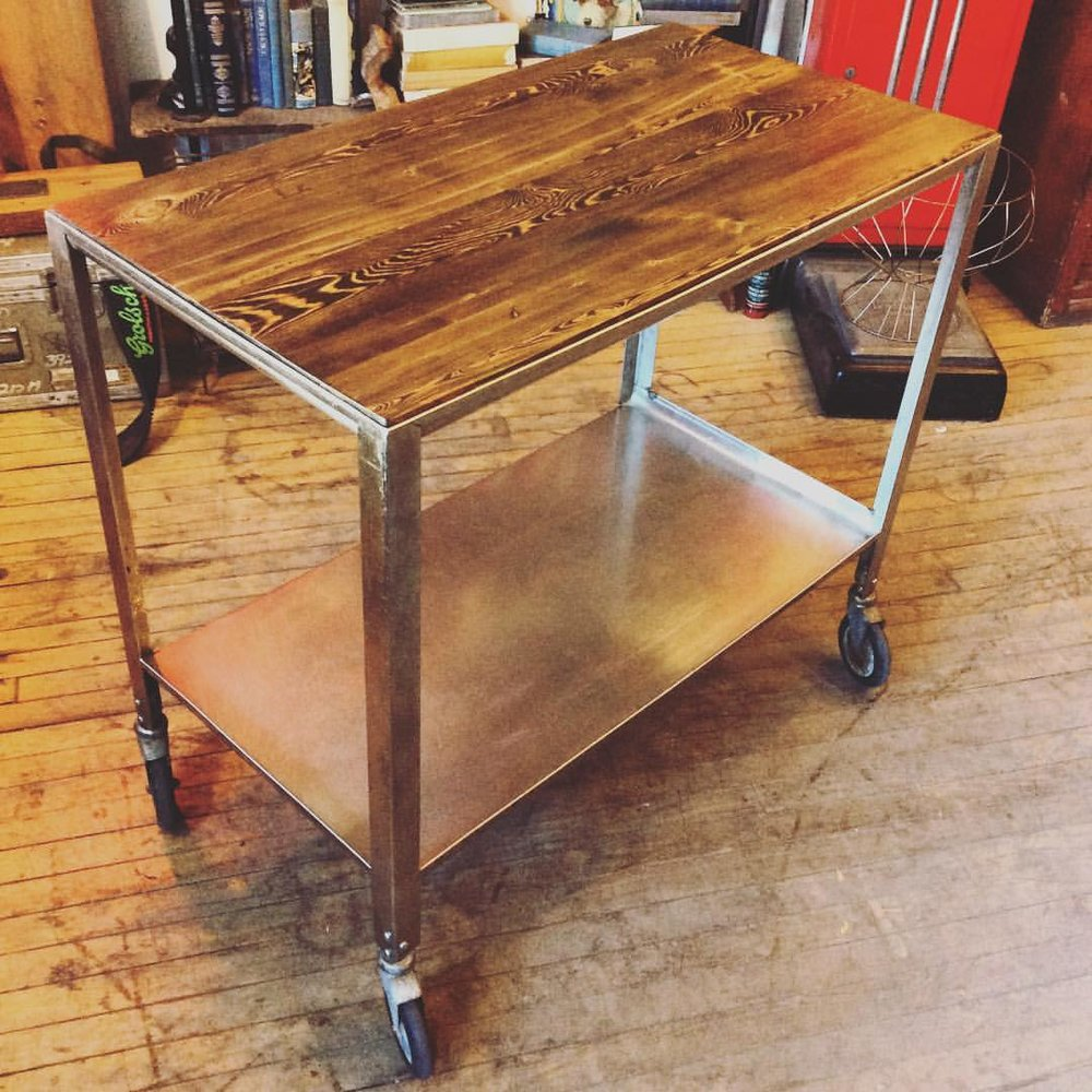 $ 325 Rolling metal food cart with reclaimed wood table top. These carts were sourced from a Canadian Prison and made into these handy kitchen carts!