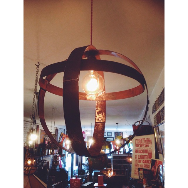 $125 Salvaged wine barrel braces, repurposed into a gorgeous sphere hanging light. Pairs nicely with a round Edison bulb and our red Edison cloth wire.
