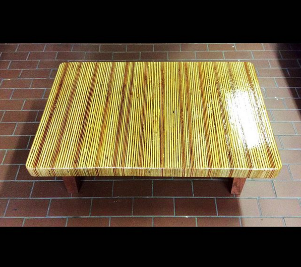 "$ Inquire A ""rainbow table"" made of assorted reclaimed wood with African cherry legs. At Coffee table height. 41"" L x 27"" W x 19"" H"