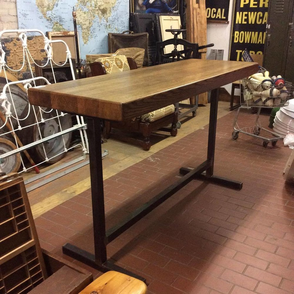 $1500 Salvaged solid oak bar top with fabricated steel base. 72'' x 24 1/4'' x 42 1/4'' Bar Height.