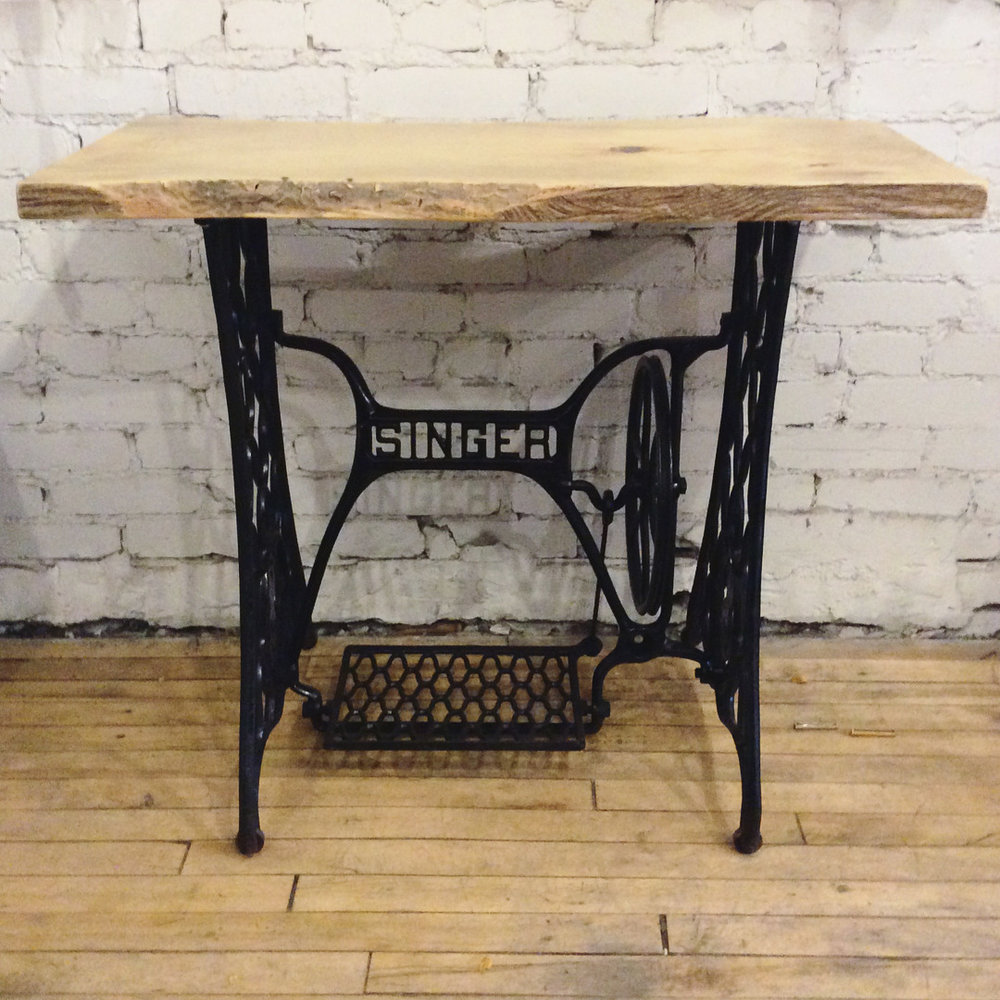 $400 Reclaimed Singer sewing machine cast iron base with pine wood live edge top. 34 5/8'' x 17 1/2'' x 29 7/8''