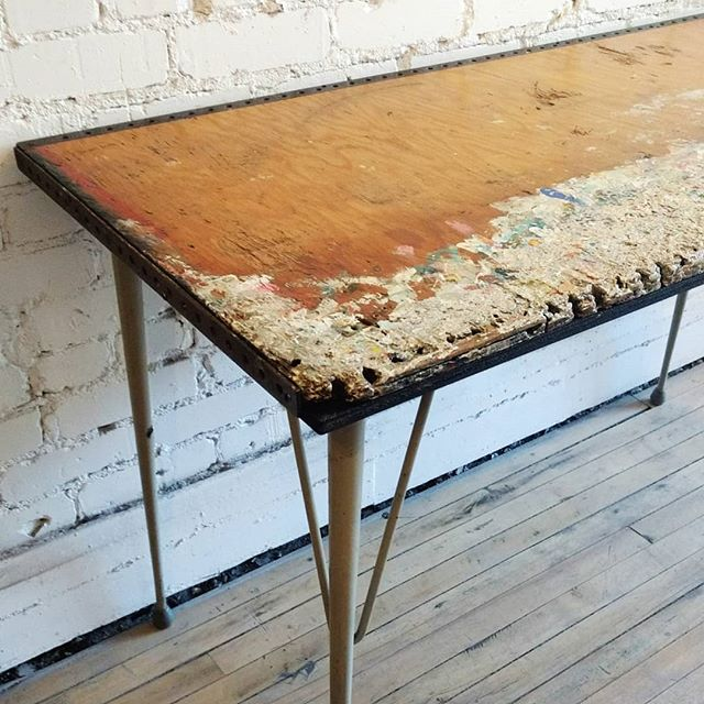 Add some creative flair to your workspace with this artist table covered in a lifetime's worth of gorgeous paint drippings. . . . #junctionstores #junctionto #antiques #salvage #madeinthejunction #vintage #design  #interiordesign #reclaimedwood #reducereuserecycle #woodworking #customfurniture #bespoke #architecturalsalvage