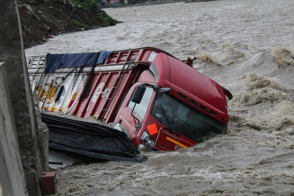 A truck that was parked next to the Rio Santa river was claimed by erosion, with it food and resources. The raging river continues to rise and endanger the lives of people who live closest to it.