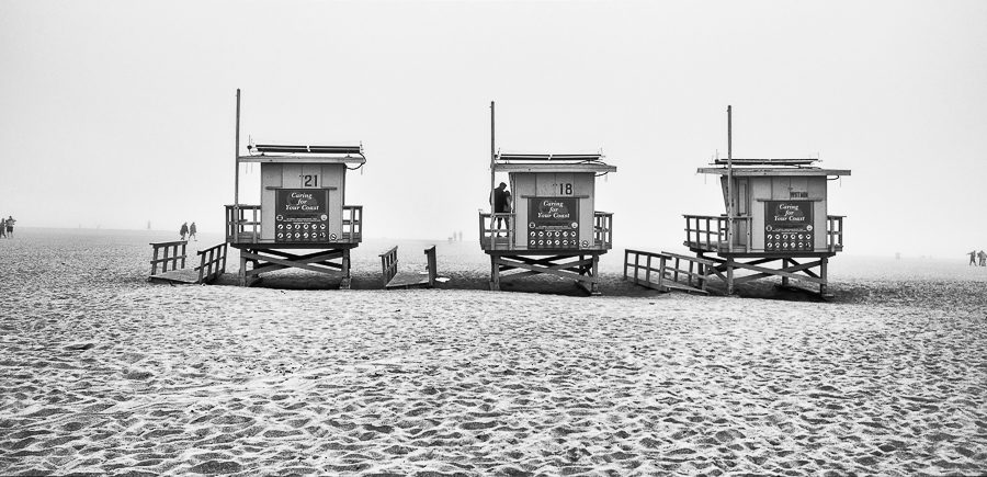 Photographer: Michael Nozik   Country: USA  Title: Two lovers snuggle on a foggy day at the beach