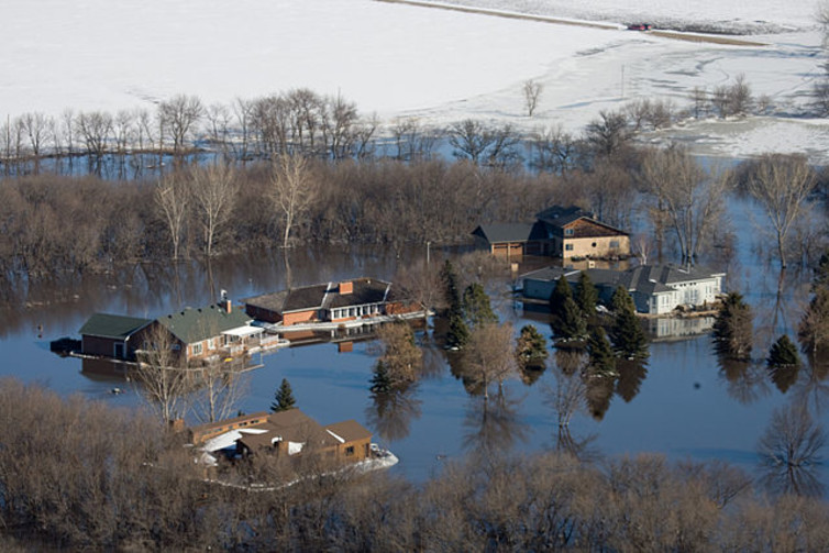 Flooded farms in North Dakota, March 28, 2009. Farmers are vulnerable to floods, drought and other natural disasters that may be worsened by climate change. FEMA/Wikipedia