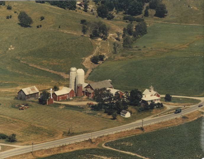 "The Farm Between in 1992. Note the erosion on the hillside. FDR once said that ""a nation that destroys its soil, destroys itself."" Globally, cropland loses 10 tonnes of soil per hectare per year, which amounts to 250 5-gallon buckets per acre. This results in trillions of dollars in lost yields, but let's look at the bright side. We know how to fix things like this, and the solution involves trees."