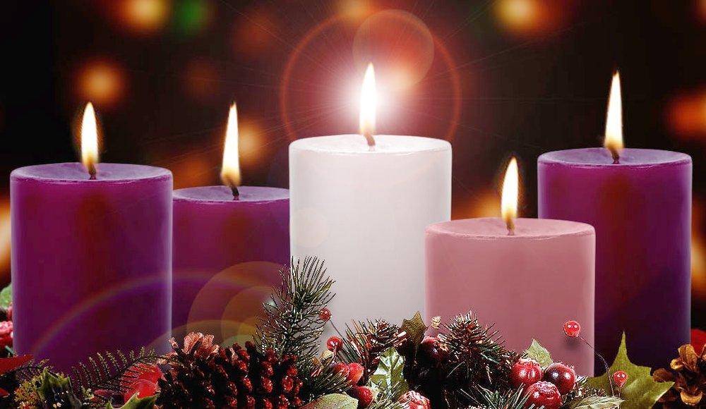 """The Advent Wreath has a long tradition in both the Protestant and Catholic religions. It is believed to have started as a pre-Christian activity by the Germanic and Scandinavian people's practice of using evergreen wreaths to hold candles during the long cold dark nights of the northern winters. The candles brought light to chase away the darkness and the greenery brought pleasant thoughts of the spring which will soon arrive. The practice was adopted into the Christian religion during the Middle Ages and used as a visual aid to help believers prepare their hearts and minds for Christ's Second Coming. It later evolved into receiving the gift of the Christ Child at Christmas. The wreath changed into an evergreen circle representing the continuous life found in God and candles were given meanings of hope, peace, joy and love.  This Advent Wreath picture was taken from St. Patrick's Church Hamtilon, Ontario. http://www.stpatrickshamilton.ca/advent-wreath-5/  Reference materials from Rev. William Saunders """"The History of the Advent Wreath""""  https://www.catholiceducation.org/en/culture/catholic-contributions/the-history-of-the-advent-wreath.html"""