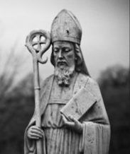 As time passed legends of the Saint who saved Ireland for Christianity grew in the telling. One story is that Patrick drove the snakes from Ireland. To be clear Ireland never did have snakes. The actions surrounding the event probably go back to the conflicts Patrick had with the druids who were the non-Christian religious leaders of Ireland in the 400s.   http://blog.godreports.com/wp-content/uploads/2018/03/St.-Patrick-black-and-white.jpg